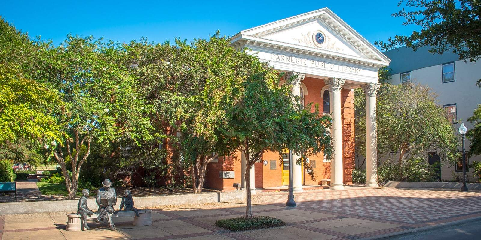 Carnegie Public Library tall building with white columns in Bryan