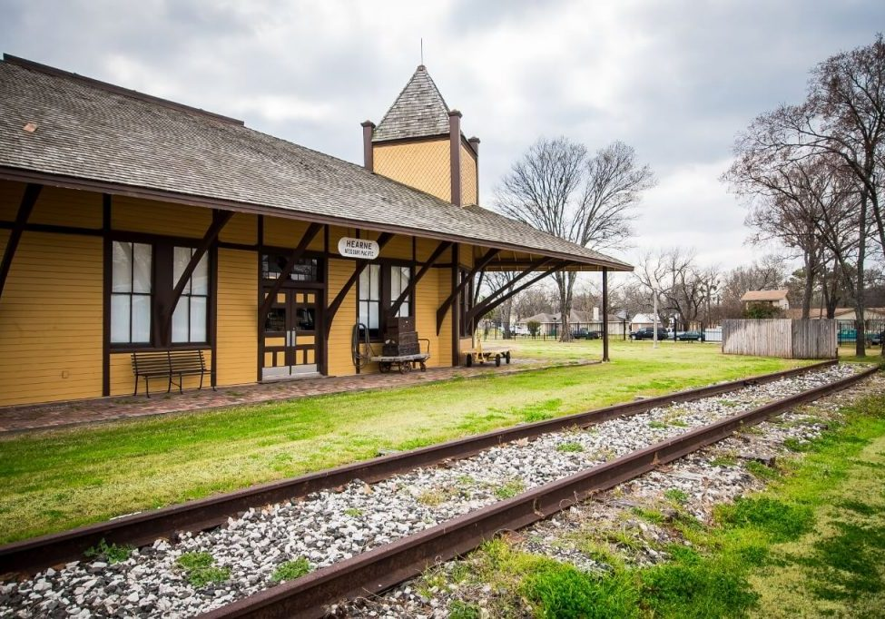 Hearne train station museum with railroad track